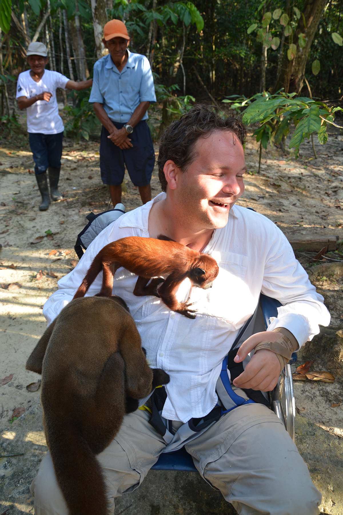 Dan Eley playing with monkeys at Tanimboca National Reserve