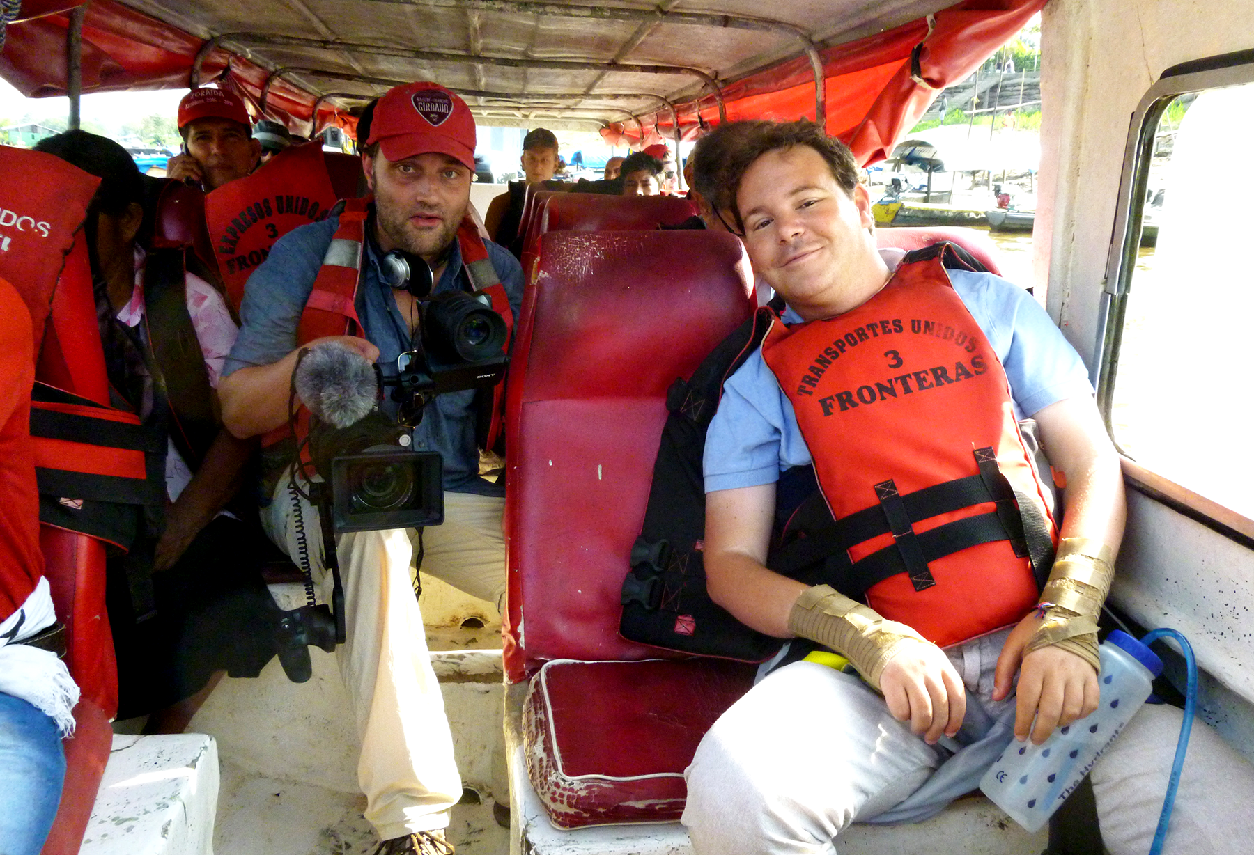 Dan Eley Seated on boat on Amazon Trip