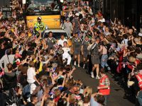 Dan carries the Olympic torch through his hometown in 2012