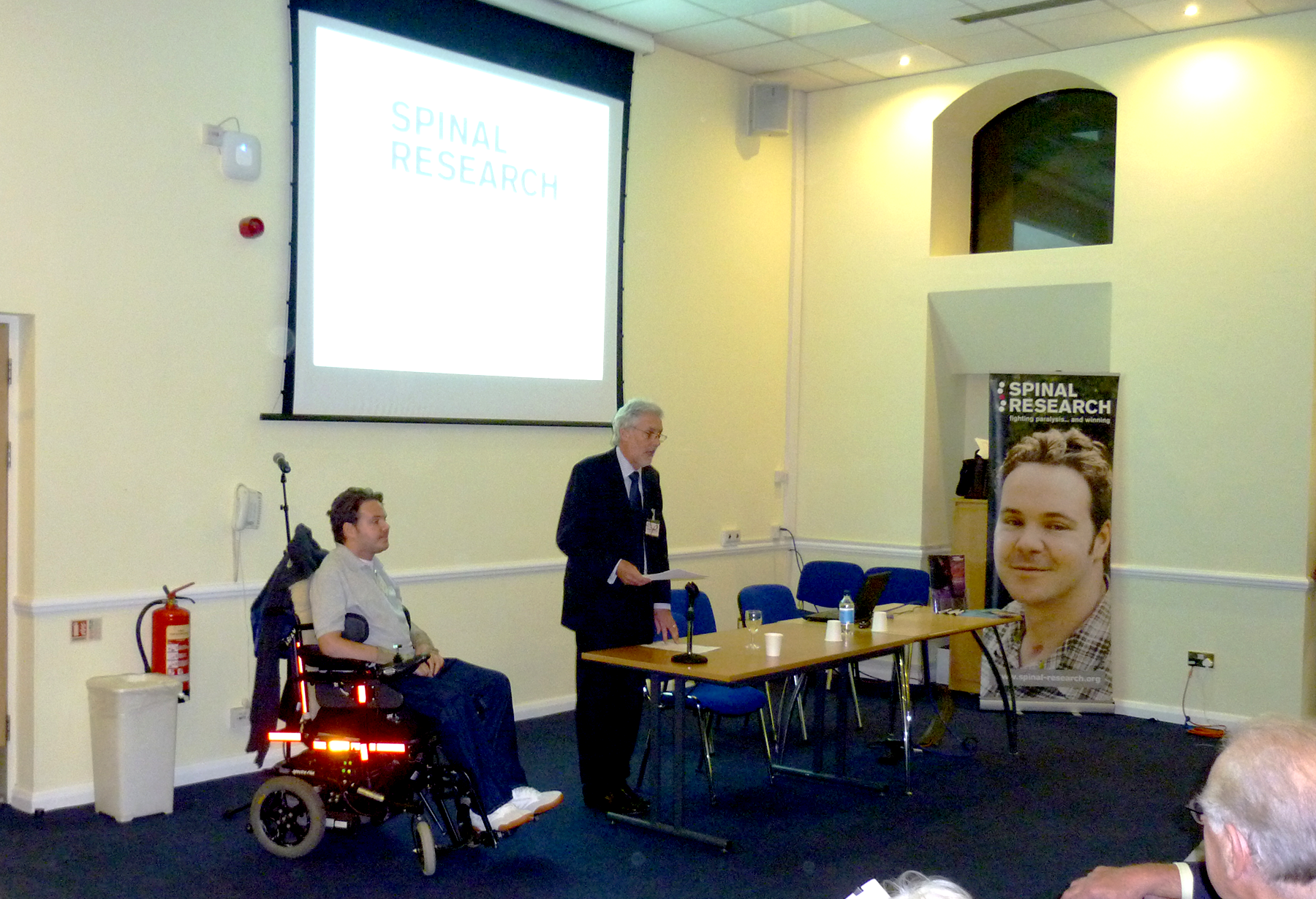 Dan Eley speaking at Spinal Research event at Kings College
