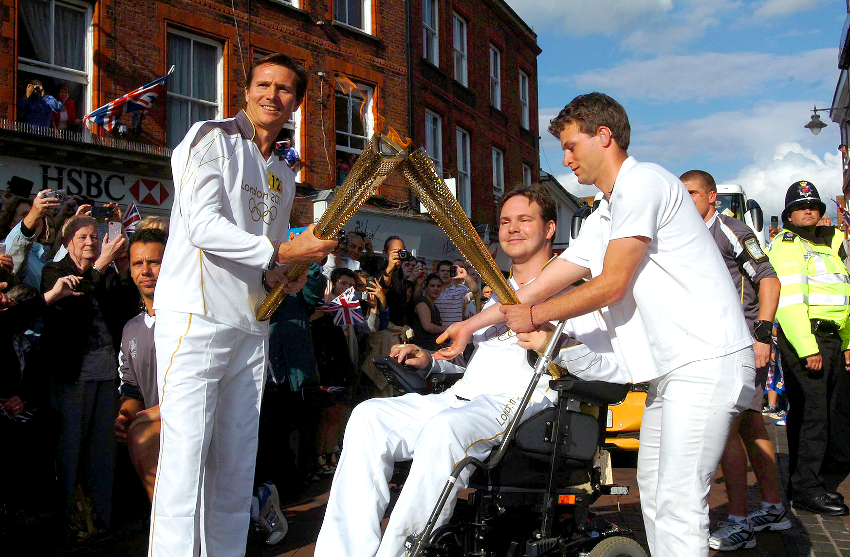 Dan Eley carrying the Olympic Torch